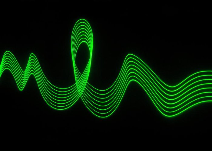 Laser Greeting Card featuring the photograph Green Abstract Coloured Lights Trails by John Rensten