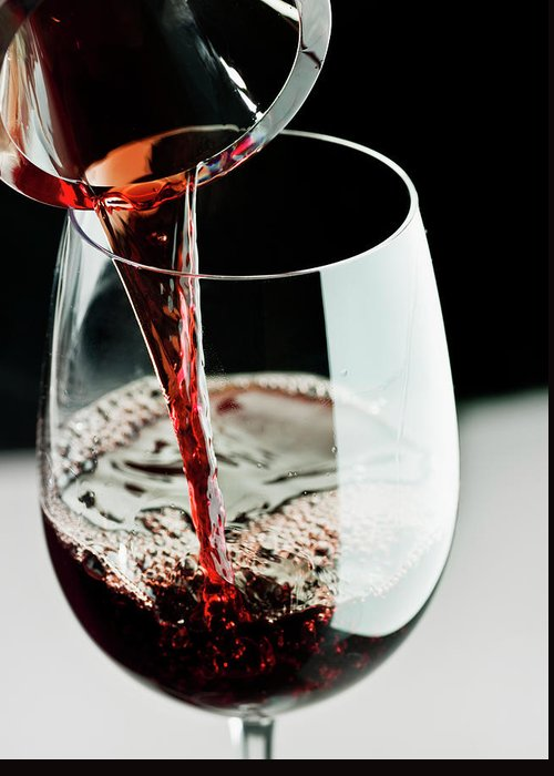 Alcohol Greeting Card featuring the photograph Red Wine Being Poured In A Glass by Juanmonino