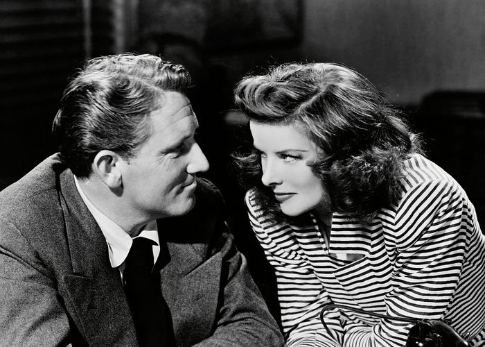 SPENCER TRACY and KATHARINE HEPBURN in WOMAN OF THE YEAR -1942-. Photograph by Album