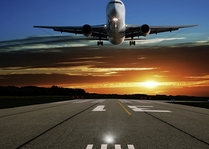 Orange Color Greeting Card featuring the photograph Xl Jet Airplane Landing At Sunset by Sharply done