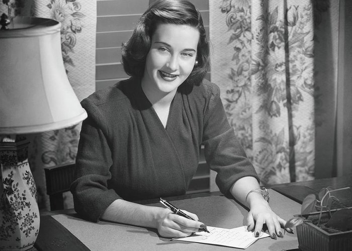 People Greeting Card featuring the photograph Young Woman Writing Letter At Desk, B&w by George Marks