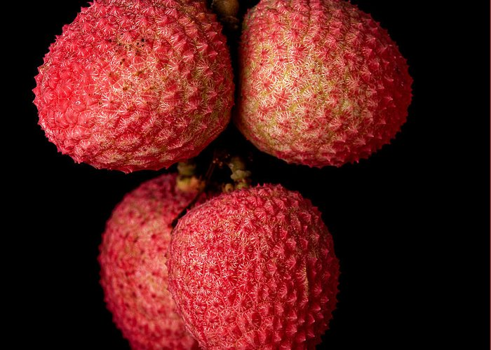 Pink Greeting Card featuring the photograph A Bunch Of Lychees Against A Black by Hein