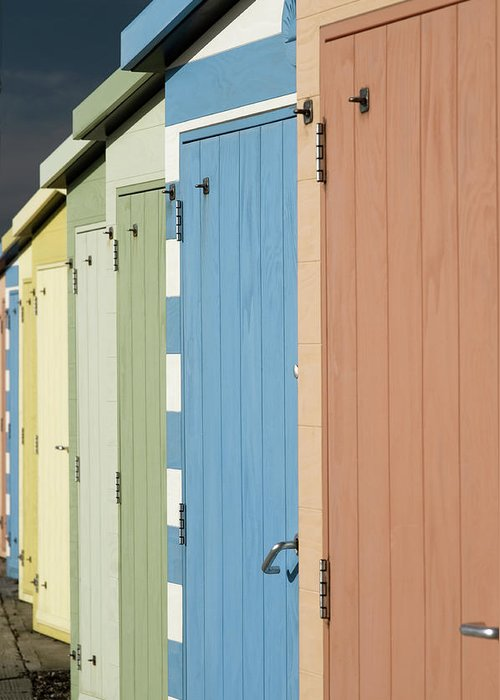 Beach Hut Greeting Card featuring the photograph A Row Of Beach Huts by Matthew Piper