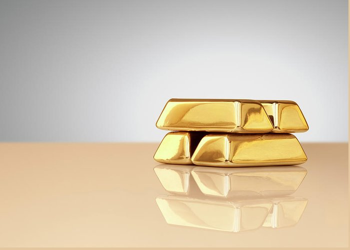 Four Objects Greeting Card featuring the photograph A Stack Of Four Gold Ingots by Anthony Bradshaw