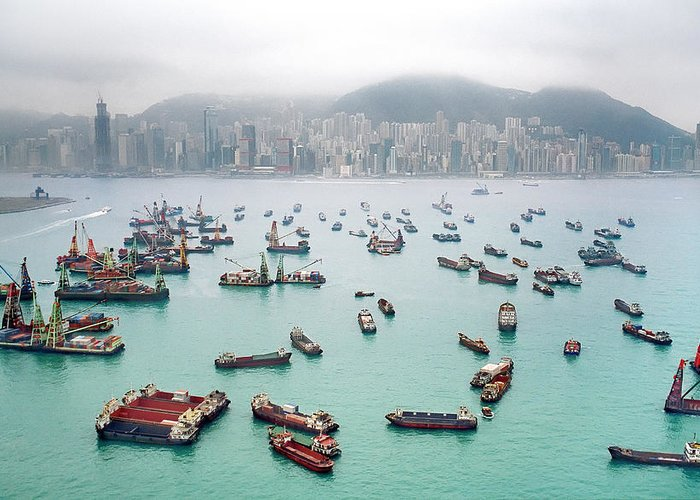 Trading Greeting Card featuring the photograph A View Of Hong Kong Harbor Through A by Xpacifica