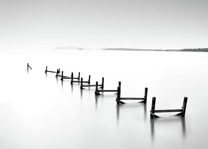 Tranquility Greeting Card featuring the photograph Abandond Jetty by Photography By Azrudin