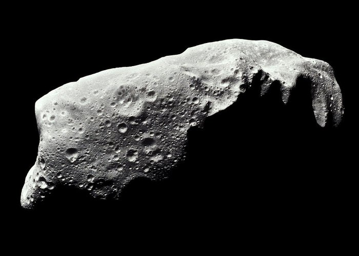 Toughness Greeting Card featuring the photograph Asteroid 243 Ida by Stocktrek
