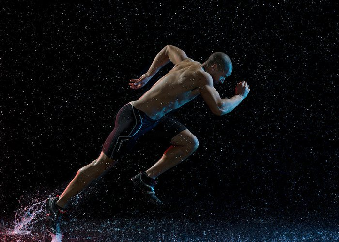 People Greeting Card featuring the photograph Athlete Runner Running Through Rain by Jonathan Knowles