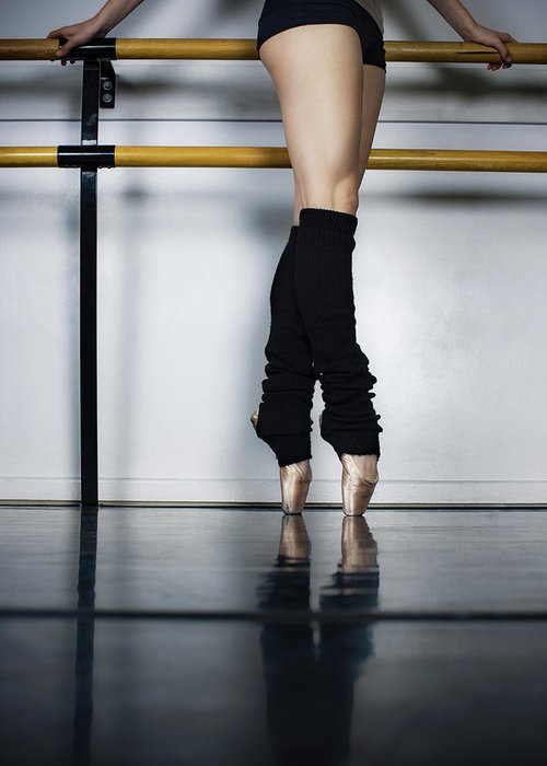 Ballet Dancer Greeting Card featuring the photograph Ballet Holdiing Bar In Classic Pointe by Patrik Giardino