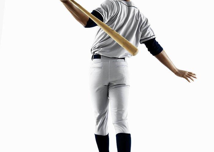Baseball Cap Greeting Card featuring the photograph Baseball Player Hitting Home Run From by Patrik Giardino