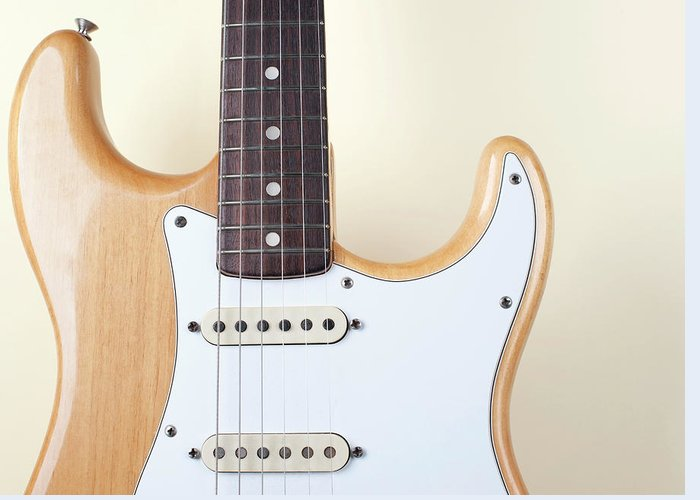 Rock Music Greeting Card featuring the photograph Beige Wood Textured Electric Guitar by Neyya
