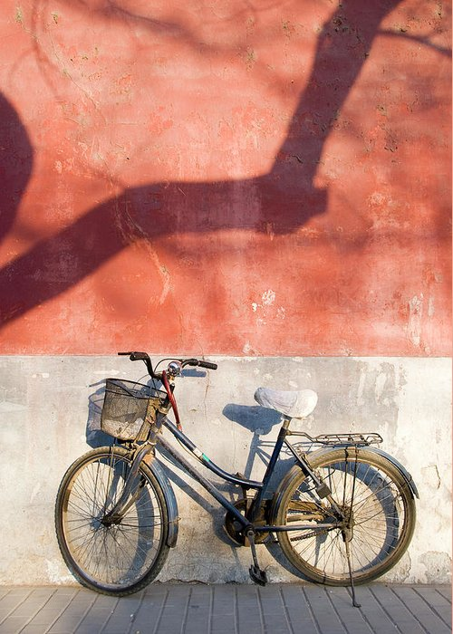 Chinese Culture Greeting Card featuring the photograph Bicycle Against Red Wall by Frankvandenbergh
