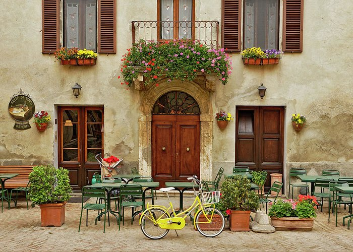Pienza Greeting Card featuring the photograph Bicycle In Front Of Small Cafe, Tuscany by Adam Jones