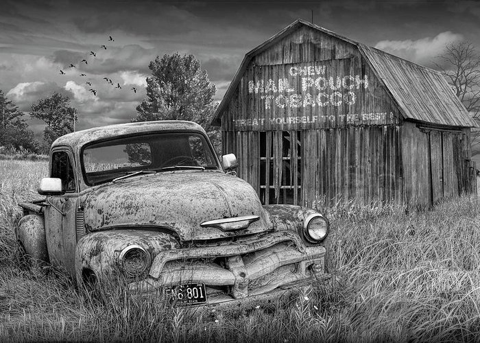 Chevy Greeting Card featuring the photograph Black And White Of Rusted Chevy Pickup Truck In A Rural Landscape By A Mail Pouch Tobacco Barn by Randall Nyhof