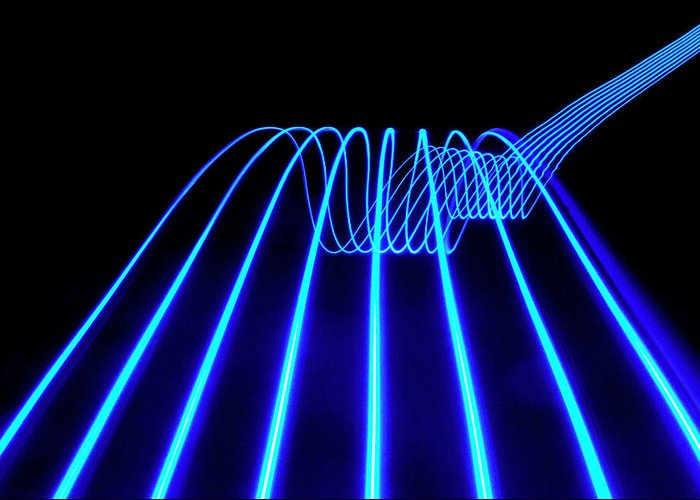 Laser Greeting Card featuring the photograph Blue Abstract Coloured Lights Trails by John Rensten