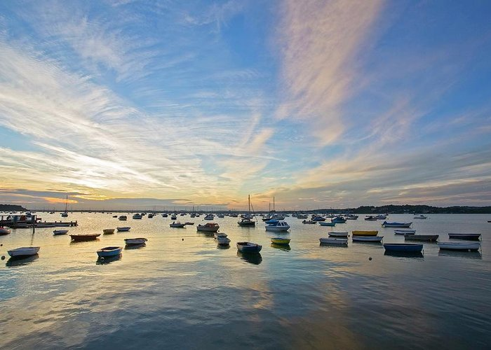 Tranquility Greeting Card featuring the photograph Boats Anchored In Water At Poole by David Henderson