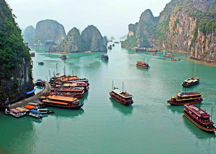 Tranquility Greeting Card featuring the photograph Boats Of Halong Bay by Joe Regan
