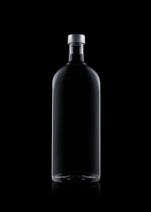 Black Color Greeting Card featuring the photograph Bottle Of Water Isolated On Black by Kedsanee