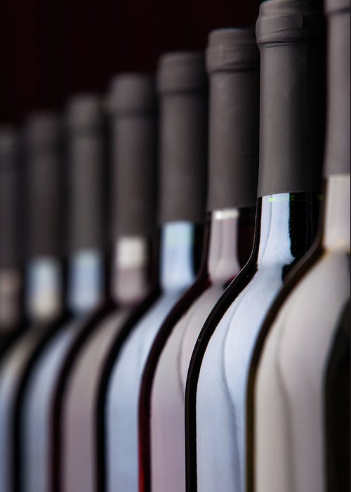 Alcohol Greeting Card featuring the photograph Bottles Of Wine In A Row by Halbergman