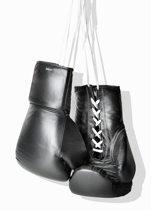 Hanging Greeting Card featuring the photograph Boxing Gloves Hanging Against White by Burazin