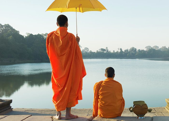 Young Men Greeting Card featuring the photograph Buddhist Monks Standing In Front Of by Martin Puddy