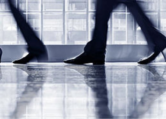 Corporate Business Greeting Card featuring the photograph Businesspeople Walking In Lobby, Low by Poba