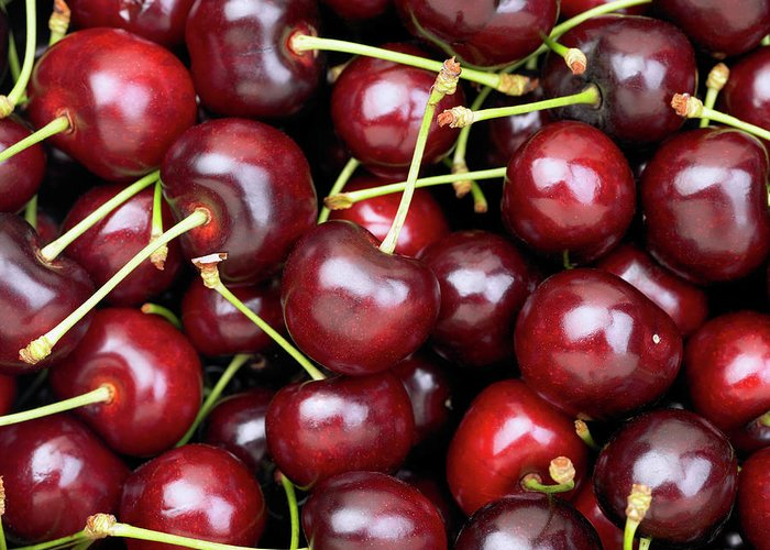 Cherry Greeting Card featuring the photograph Cherries by Maria Toutoudaki