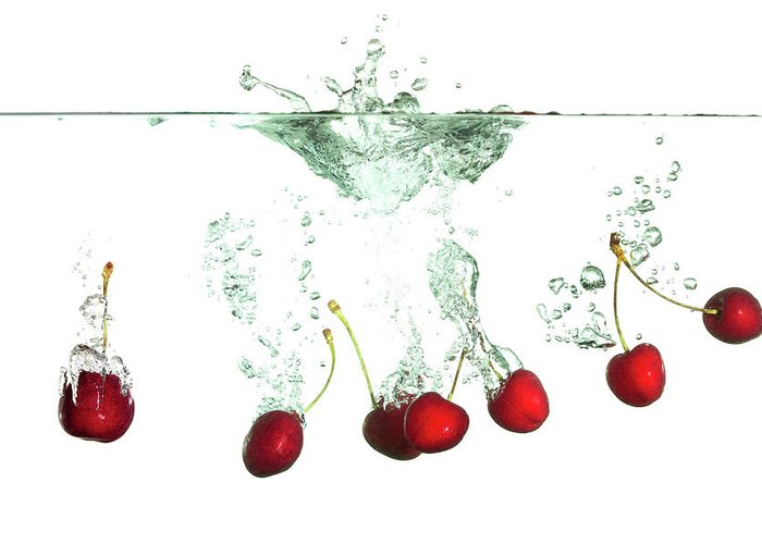 Cherry Greeting Card featuring the photograph Cherries Splash by Asbe