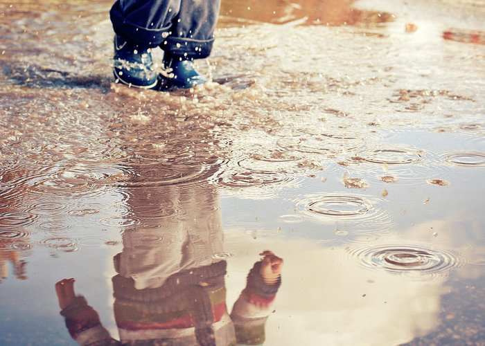 Toddler Greeting Card featuring the photograph Child In A Puddle by Vpopovic