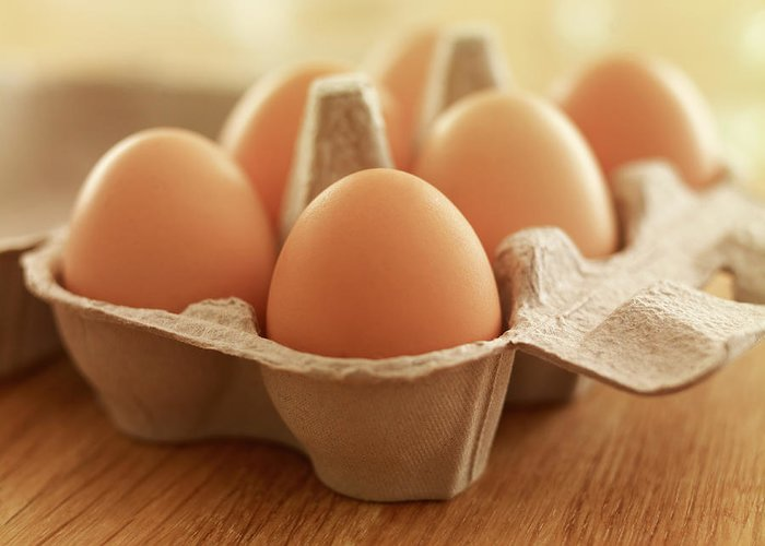 Free Range Greeting Card featuring the photograph Close Up Of Brown Eggs In Carton by Adam Gault