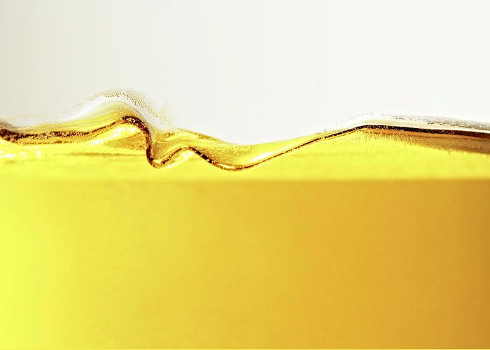 Motion Greeting Card featuring the photograph Close Up Of Oil In Glass by Cwp