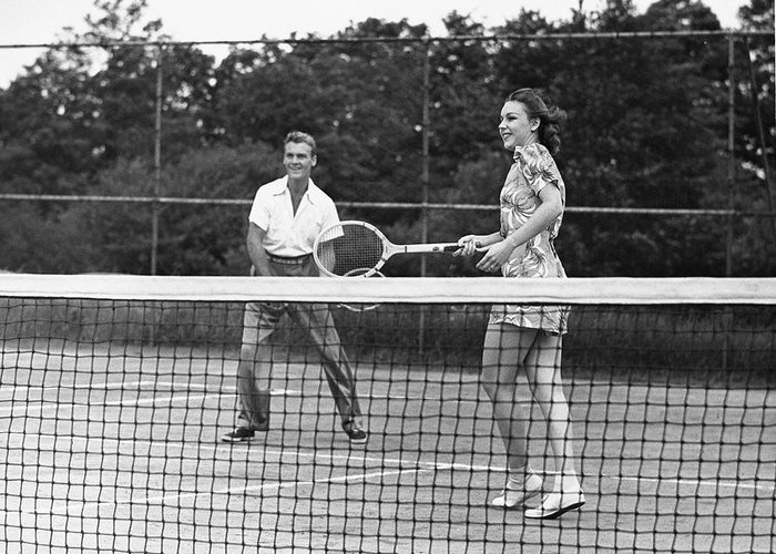 Heterosexual Couple Greeting Card featuring the photograph Couple Playing Tennis by George Marks