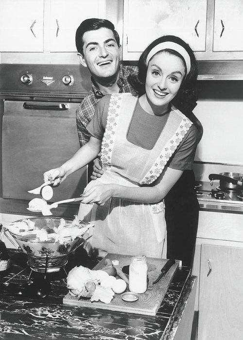 Heterosexual Couple Greeting Card featuring the photograph Couple Standing In Kitchen, Smiling, B&w by George Marks