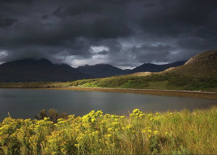 Tranquility Greeting Card featuring the photograph Dark Storm Clouds Hang Over The by John Short / Design Pics