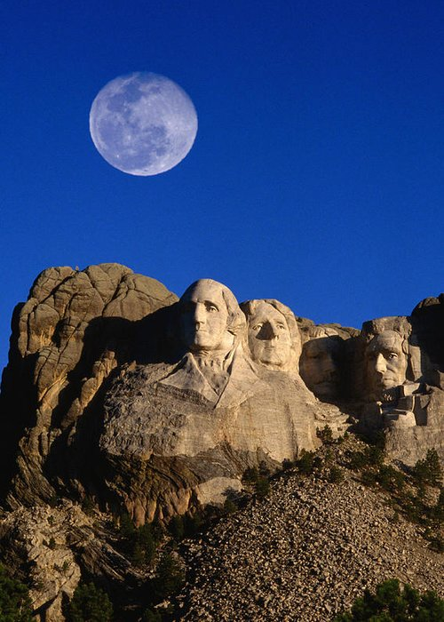 Mt Rushmore National Monument Greeting Card featuring the photograph Daytime Moon Above Presidential Faces by Mark Newman