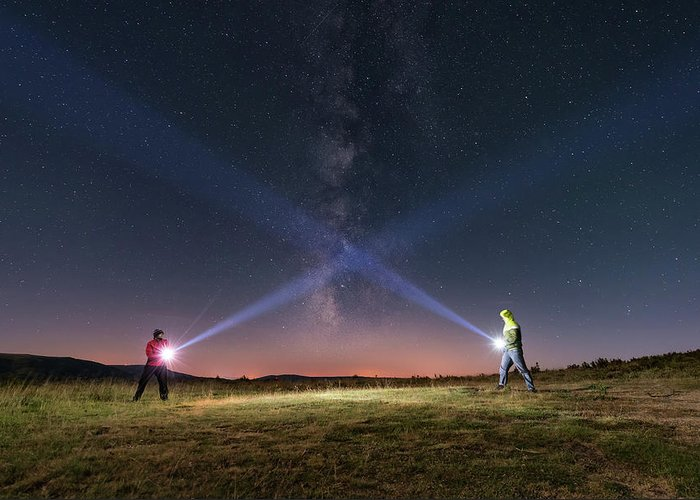 People Greeting Card featuring the photograph Duel Of Light by Carlos Fernandez