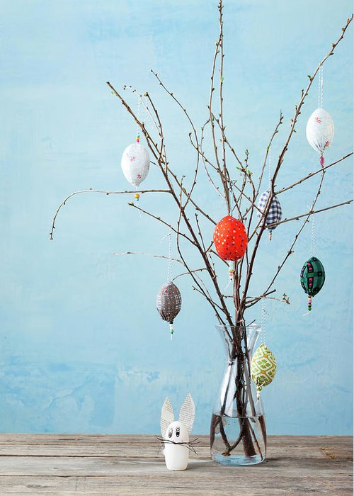 Holiday Greeting Card featuring the photograph Egg-shaped Decorations On Branches by Stefanie Grewel
