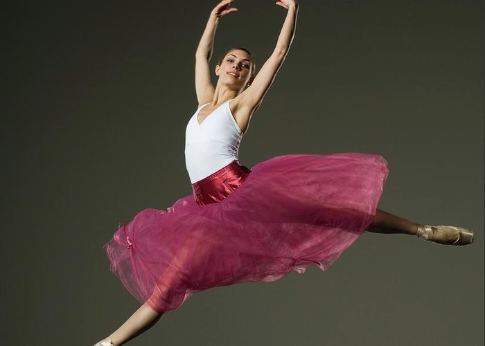 Ballet Dancer Greeting Card featuring the photograph Female Ballet Dancer Jumping by Tetra Images - Erik Isakson