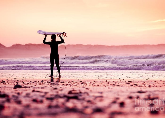 Sunrise Greeting Card featuring the photograph Female Surfer On The Beach At The Sunset by Iko