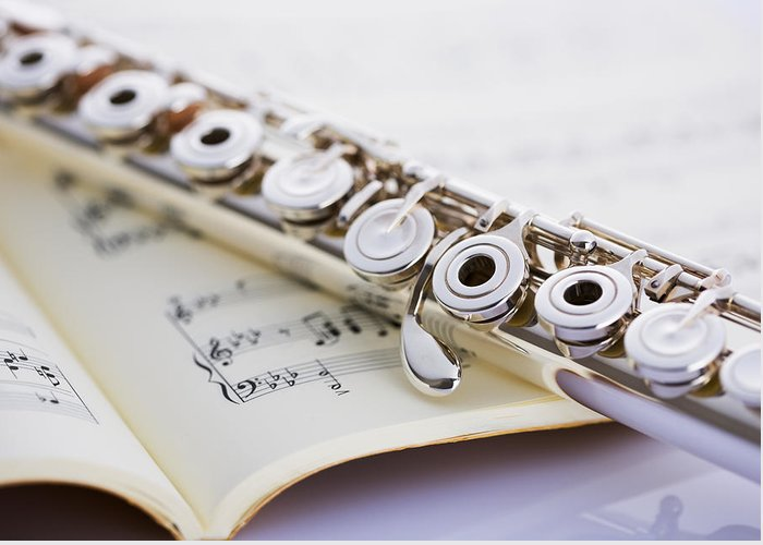 Sheet Music Greeting Card featuring the photograph Flute On A Score by Imagenavi
