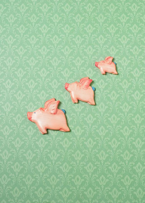 Disbelief Greeting Card featuring the photograph Flying Pig Ornaments On Wallpapered by Peter Dazeley