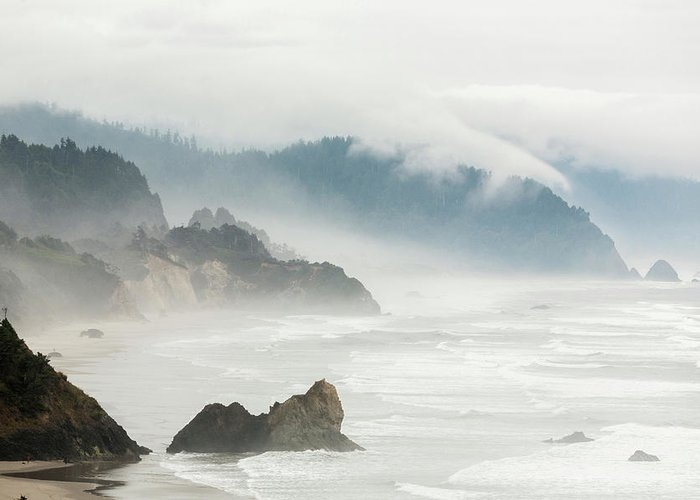 Scenics Greeting Card featuring the photograph Fog Shrouded View Of Rocky Coastline by Win-initiative