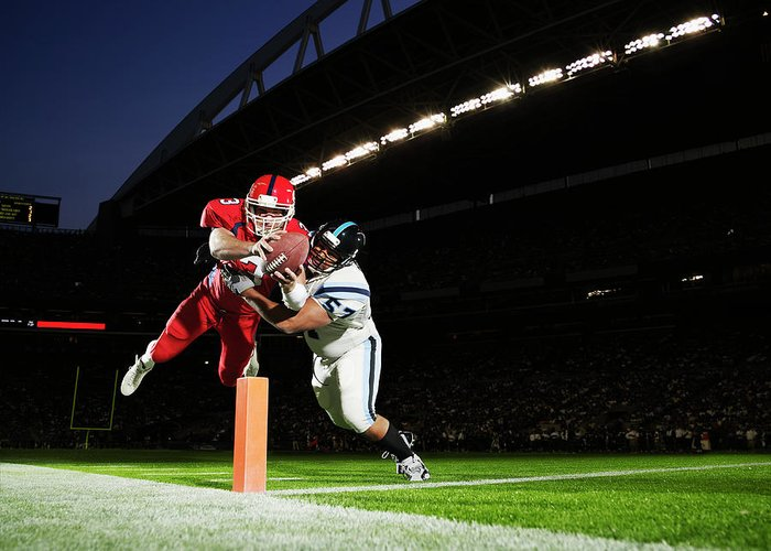 Sports Helmet Greeting Card featuring the photograph Football Player Diving Into End Zone by Thomas Barwick