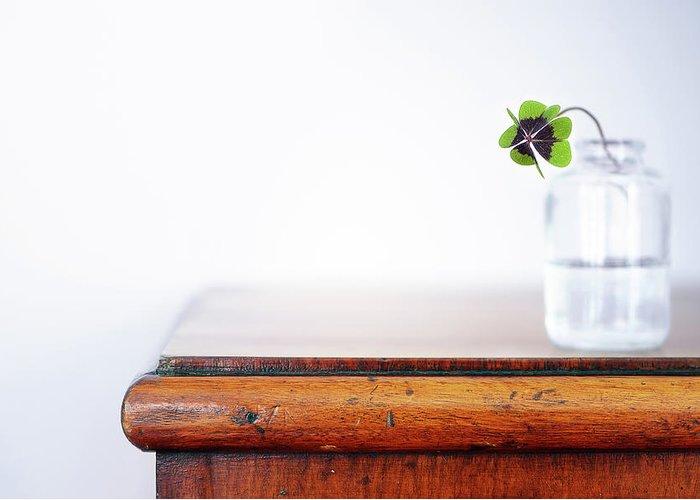 Vase Greeting Card featuring the photograph Fourleaf Cloverin Vase On Dresser by Elisabeth Schmitt