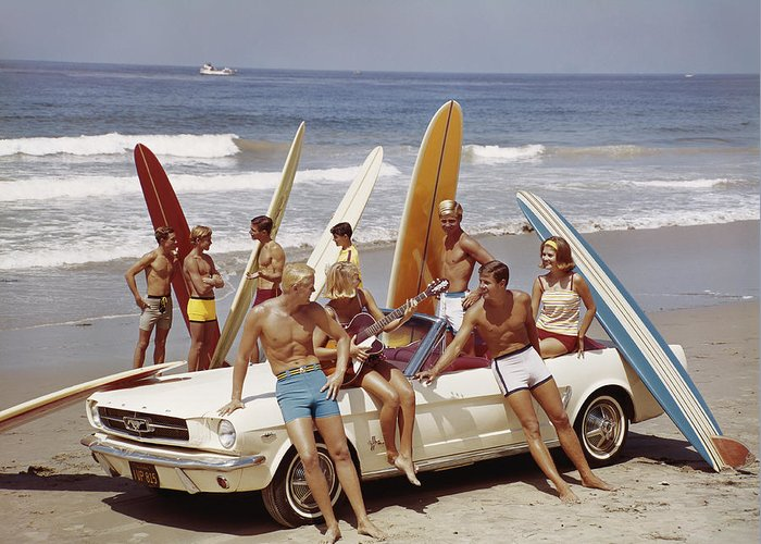 Young Men Greeting Card featuring the photograph Friends Having Fun On Beach by Tom Kelley Archive
