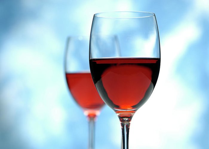 Rose Wine Greeting Card featuring the photograph Glass Of Red Wine by Pidjoe