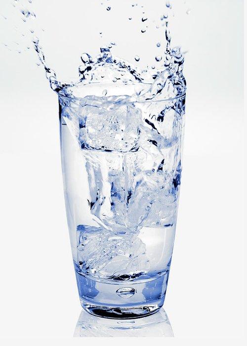 White Background Greeting Card featuring the photograph Glass Of Water Splashing Around by Maria Toutoudaki