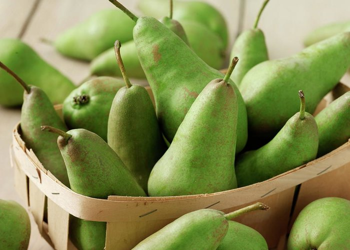 Fruit Carton Greeting Card featuring the photograph Green Pears In Punnet And Wooden Table by Chris Ted