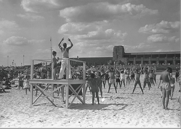 Human Arm Greeting Card featuring the photograph Group Of People Exercising On Beach, B&w by George Marks