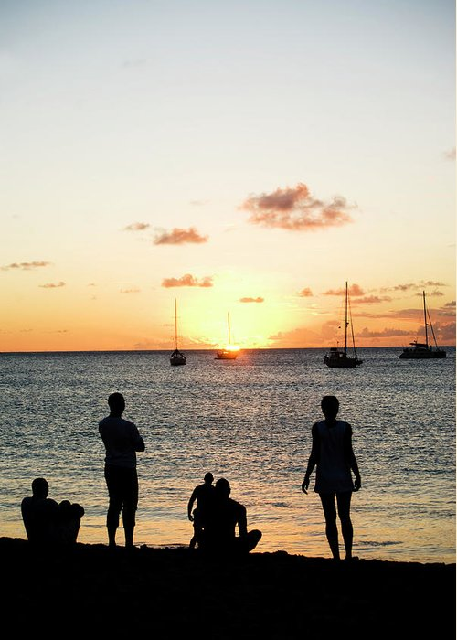 Recreational Pursuit Greeting Card featuring the photograph Group Of Young Friends On Beach At by Jaminwell